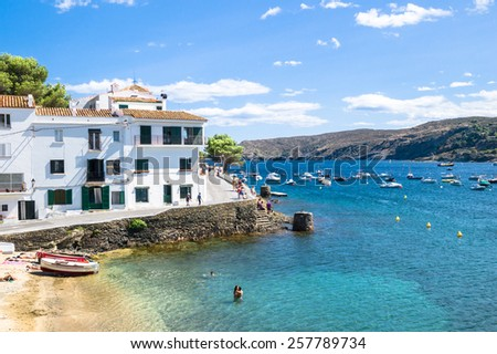 CADAQUES, SPAIN - JULY 21: View of Cadaques, one of the most touristic villages of Costa Brava, on July 21, 2014,in Port de la Selva, Catalonia, Spain.It is on a bay in the middle of the Cap de Creus. - stock photo