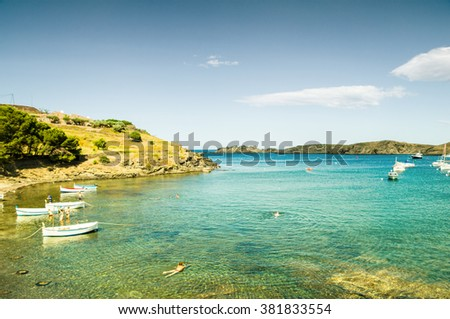 CADAQUES, SPAIN - JULY 21: View of Cadaques, one of the most touristic villages of Costa Brava, on July 21, 2014, in Port de la Selva, Catalonia, Spain. It is on a bay in the middle of Cap Creus cape. - stock photo
