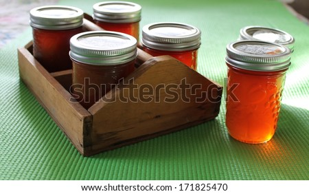 Caddy of Apple butter and jellies - stock photo