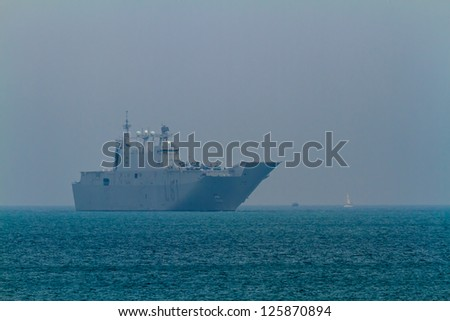 CADIZ, SPAIN-JUN 01: Aircraft carrier L-61 Juan Carlos I docking to take part in an exhibition on the day of the spanish army forces on Jun 01, 2012, in Cadiz, Spain