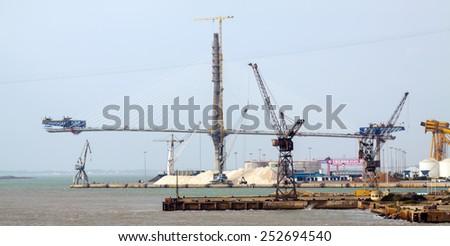CADIZ, SPAIN - NOVEMBER 20, 2014: Construction process of La Pepa Bridge over bay. Cadiz - stock photo