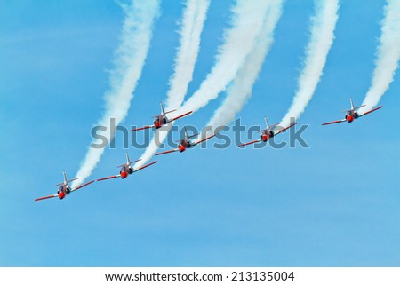 CADIZ, SPAIN-SEP 11: Aircrafts of the Patrulla Aguila taking part in an exhibition on the 4th airshow of Cadiz on Sep 11, 2011, in Cadiz, Spain - stock photo