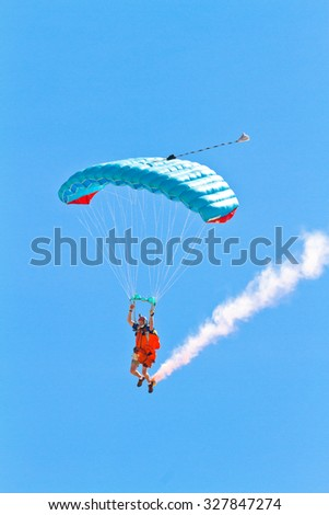CADIZ, SPAIN-SEP 11: Parachutist Rex  Pemberton taking part in  the 4th airshow of Cadiz on Sep 11, 2011, in Cadiz, Spain - stock photo