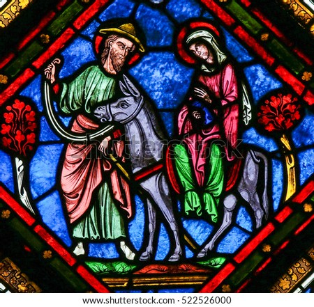 CAEN, FRANCE - FEBRUARY 12, 2013: Stained Glass window in the Cathedral of Caen, Normandy, France, depicting the Flight to Egypt