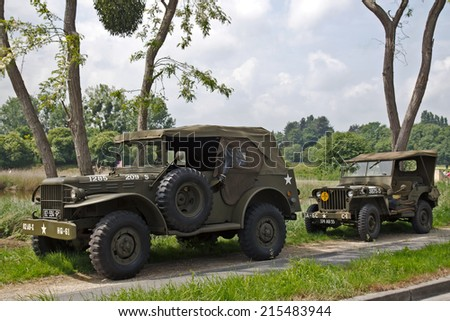 CAEN, FRANCE - JUNE 1: A WW2 US command car and jeep are parked on public display alongside the river at Pegasus bridge during the 70th anniversary D-Day celebrations on June 1, 2014 in Caen