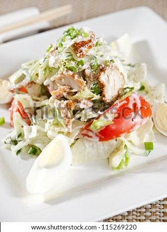 Caesar salad dish closeup - stock photo