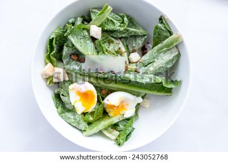 Caesar Salad in White Bowl - stock photo