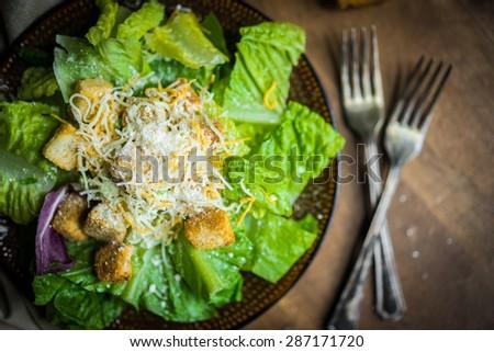 Caesar salad on rustic background - stock photo