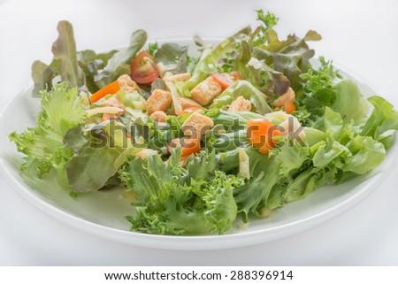 Caesar salad on white bacground - stock photo