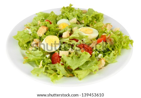 Caesar salad on white plate, isolated on white - stock photo