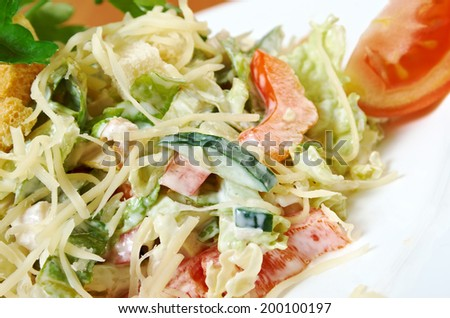 Caesar salad prepared on  classical recipe.closeup