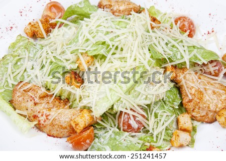 Caesar salad with chicken, cherry tomatoes, lettuce