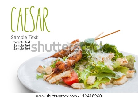 Caesar Salad with Chicken isolated on white. Easy removable text. - stock photo