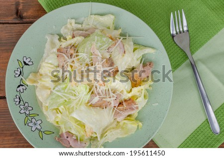 Caesar salad with parmezan on nice plate, ready to eat - stock photo