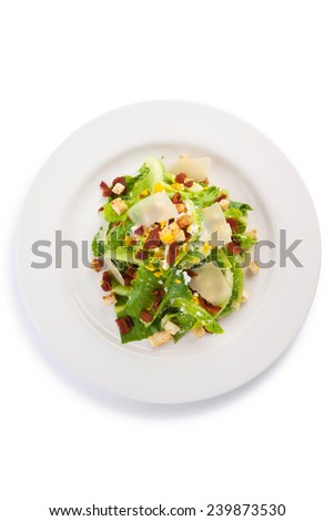 Caesar salad with quail egg, crouton, crispy bacon, isolated on white. - stock photo