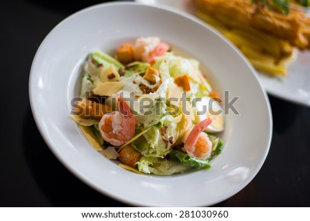 Caesar salad with shrimp and fresh vegetables - stock photo