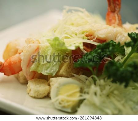 Caesar salad with shrimp, restaurant. - stock photo