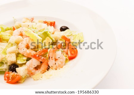 caesar salad with shrimps - stock photo