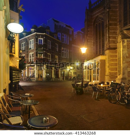 Cafe and souvenir store at back street nearby Neuwekerk church in Amsterdam - stock photo