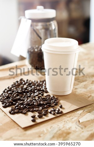 Cafe, coffee in the cup takeaway.Paper cup of coffee on the counter shop - stock photo