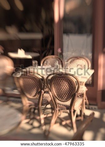 Cafe in the street an early morning - lens blurred and vintage color - stock photo
