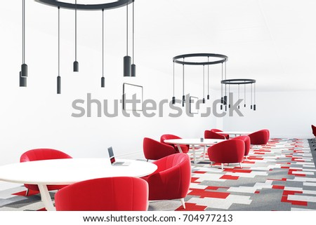 cafe interior with a gray and red carpet red armchairs standing near round tables and