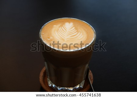 Cafe latte art. Flat white coffee - stock photo