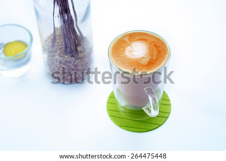 Cafe latte on white background  - stock photo