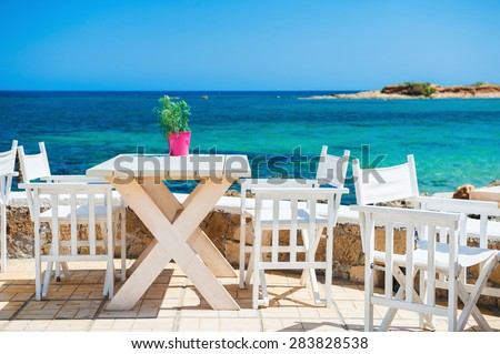 Cafe on the beach. Malia, Crete island, Greece. Beautiful tropical beach with turquoise water  - stock photo