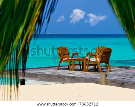 Cafe on the beach, ocean and sky - vacations background - stock photo
