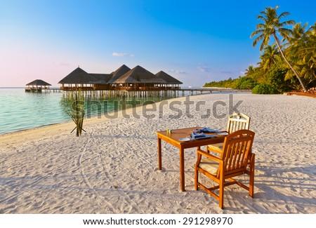 Cafe on tropical Maldives island - nature travel background - stock photo