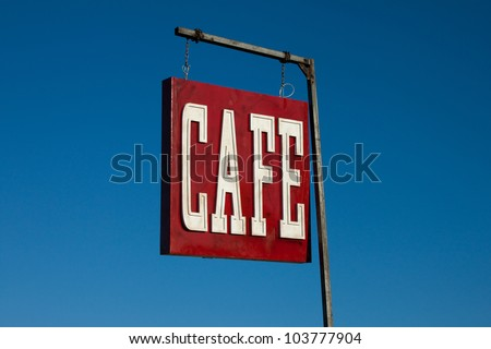 Cafe sign along historic road - stock photo