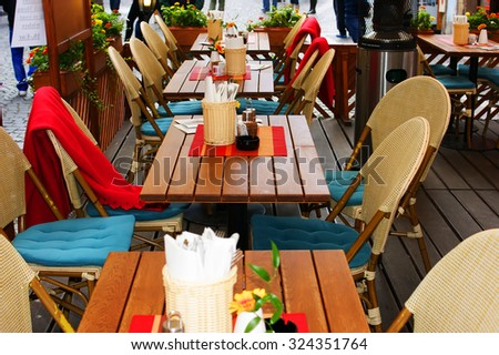 Cafe table on a street in Prague - stock photo