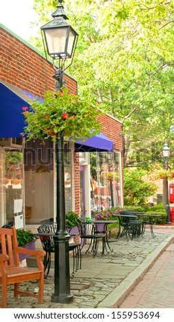 Cafe with outdoor patio in summer - stock photo