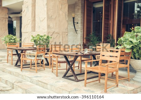 Cafe with tables and chairs in an old street in Europe with retro vintage Instagram style filter effect