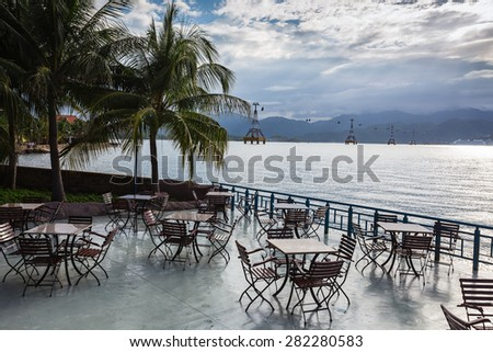 Cafe with tables on a background of the sea in Vietnam