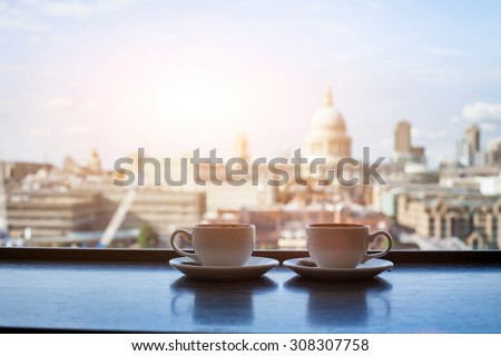 cafe with view of London, two cups of coffee and St Paul cathedral - stock photo
