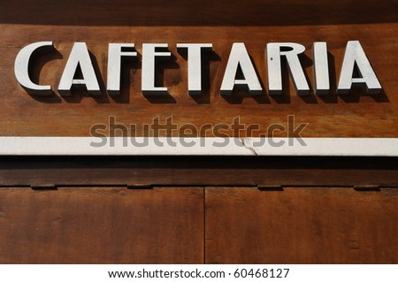 cafetaria sign (in english would be coffee house) on a wooden background