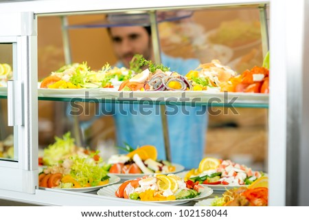 Cafeteria food display young man choose fresh salad healthy lifestyle