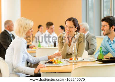 Cafeteria lunch young business people eat salad at office canteen - stock photo