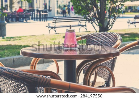 Caffee table outdoor on sunny day in town center - stock photo