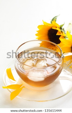 caffeine-free Roasted barley tea with sun flower for japanese summer drink image