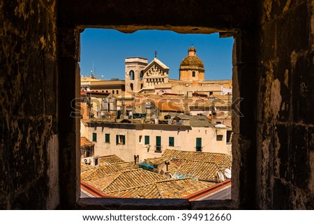 Cagliari - capital of Sardinia. Sardegna wide angle view. Roofs and houses of biggest city in Sardinia island - Cagliari, Italy. Look threw square window frame to old town center. Cagliari skyline. - stock photo
