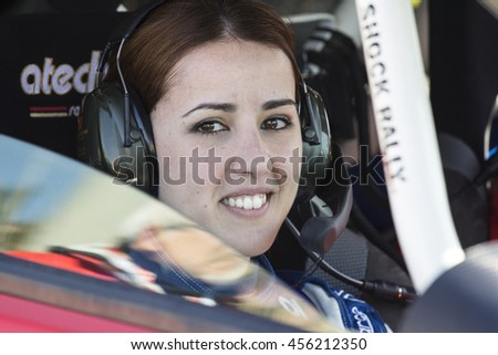CAGLIARI, ITALY - March 7th, 2015: 1st rally Cagliari - starting from the port of Via Roma - Sardinia - portrait of a smiling girl who takes part in the race as a navigator
