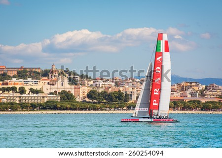 Cagliari - 10 March 2015 : America's Cup Luna Rossa catamaran sails for training session in the Gulf of Cagliari,no special event, no credit or release needed. In the background the church of Bonaria. - stock photo