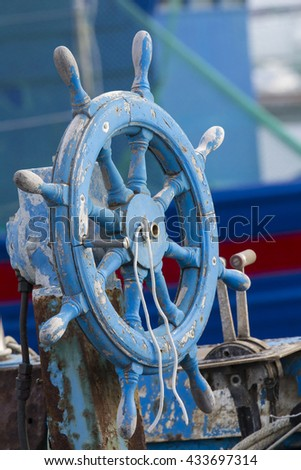 Cagliari: wheel of an old boat anchored in the tourist port of Marina Piccola - Sardinia - stock photo
