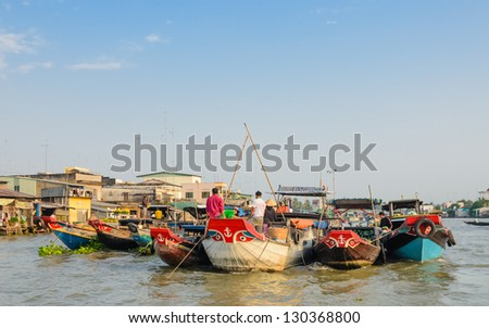 CAI BE TOWN, TIEN GIANG PROVINCE, VIETNAM - FEB 02: Unidentified trader on their boats at Cai Be Floating Market on February 02, 2013. Cai Be Market is one of most famous floating market in Vietnam. - stock photo