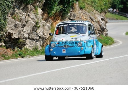CAINO (BS), ITALY - JUNE 27: A gray and blue Fiat Abarth 595 takes part to the Nave Caino Sant'Eusebio race on June 27, 2015 in Caino (BS). The car was built in 1970. - stock photo
