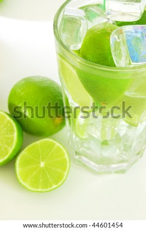 Caipirinha cocktail with green lemon and ice cubes