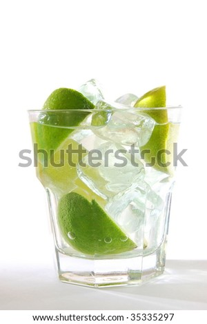 Caipirinha cocktail with lime on white background